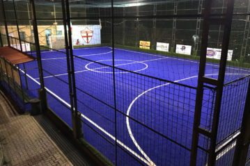 Night view of the mini-hockey pitch with the new blue synthetic turf