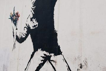 Betlemme, territori occupati di Palestina: Banksy, Love Is In the Air (Flower Thrower), 2003 (Ph. VanderWolf Images / Shutterstock, 2010).