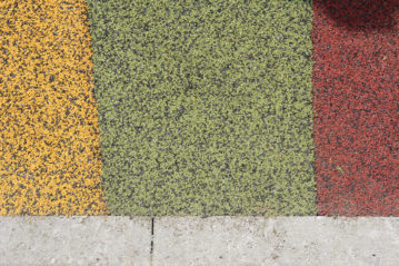 Superfici colorate dei tappeti antitrauma