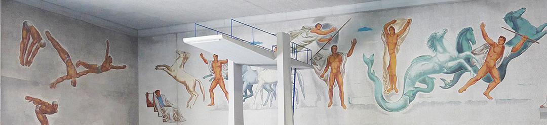 I mosaici parietali di Angelo Canevari dietro il trampolino