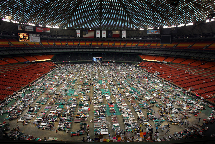 Victims of Hurricane Katrina stay at the Astrodome stadium where 16,000 evacuees are receiving food and shelter in Houston, Texas September 4, 2005. The arena is being used as an intake facility where medical care is provided and evacuees of Hurricane Katrina are evaluated for assignment to other facilities. Pictures of the Year 2005 REUTERS/Carlos Barria CB/SA - RTRMLYO